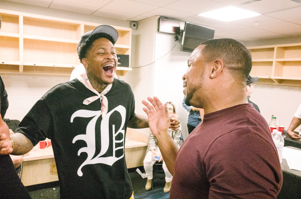 YG greeting a homie in his dressing room, 2017