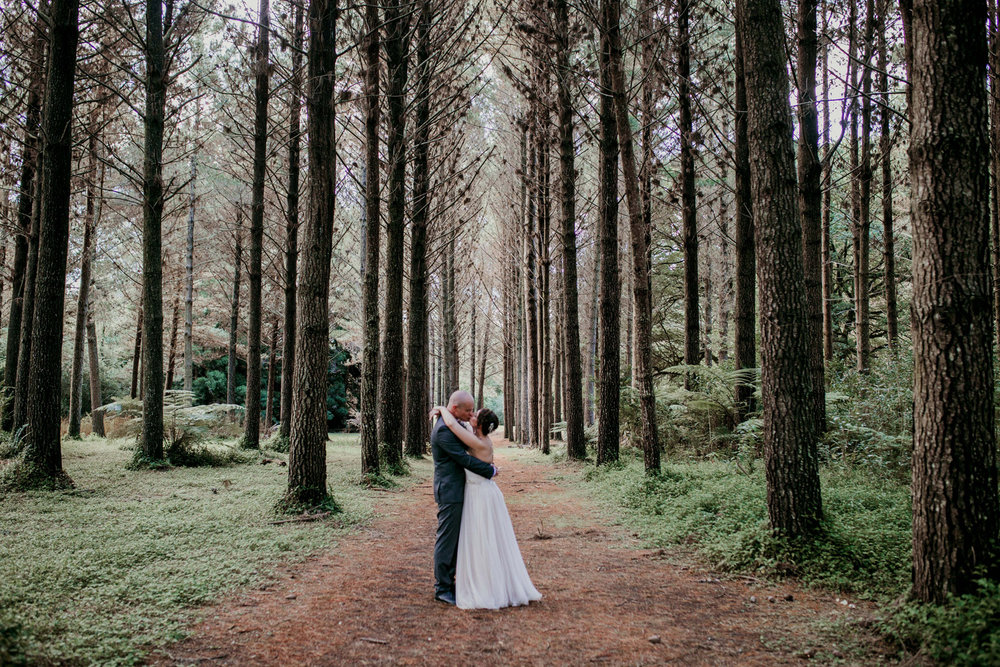 Bride and groom in the woods at Hunua Falls