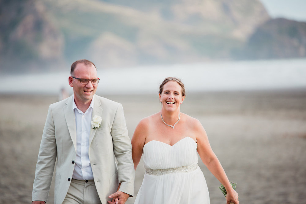 Beach wedding photo at Piha Auckland