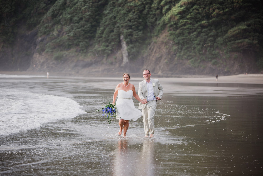 Bride and groom wedding photo at North Piha beach