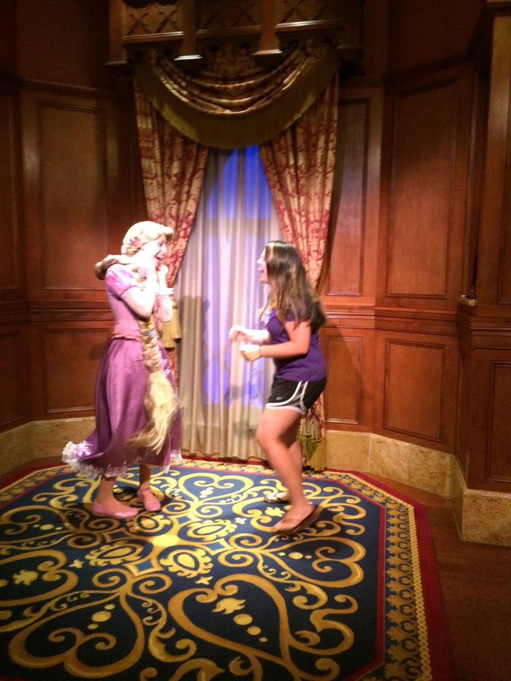 This picture is so bad, because the lighting inside Princess Fairy Tale Hall is awful! But the pure joy in this picture is unbeatable!