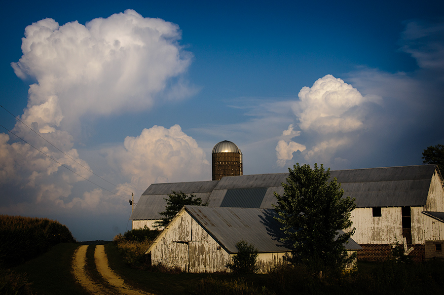 Farm and thunderheads