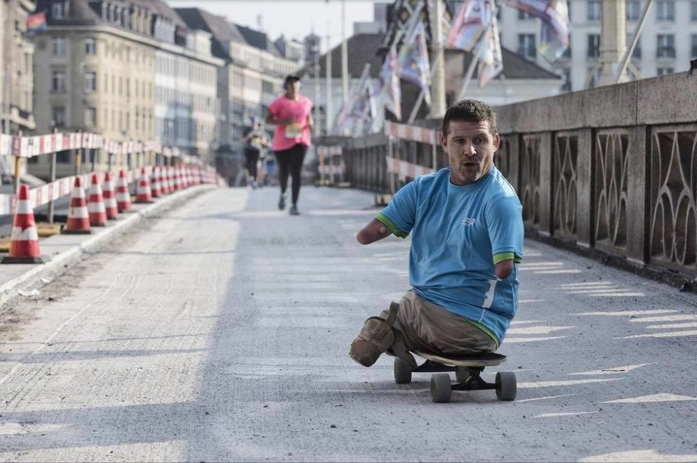 On September 24, 2017, Chris long boarded the 10K of the IWB Basel Marathon through the streets of Basel, Switzerland. With a completed time of 1 hour 1 minute and 17 seconds, it was a huge change in scenery for Chris doing a race in Switzerland. Historic buildings (some up to 600 years old) and cobblestone paths covered the route that was taken by over 1,800 participants and over 4,000 spectators watched the event. Chris happened to draw the attention of local newspapers, photographers and a local television station, TeleBasel, which he got an interview with. Check out the post on our  Facebook - If I Can  .