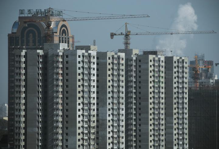 Countless cranes building countless apartment block in Beijing