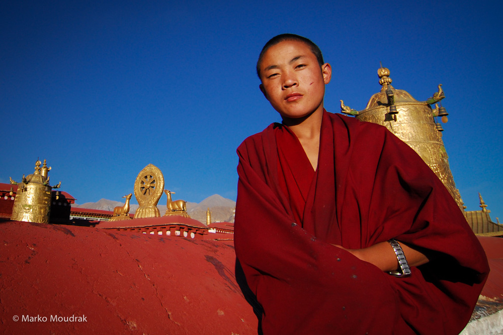 Young monk with fake rolex on top of Jokand, the holiest Bhudist temple in the world