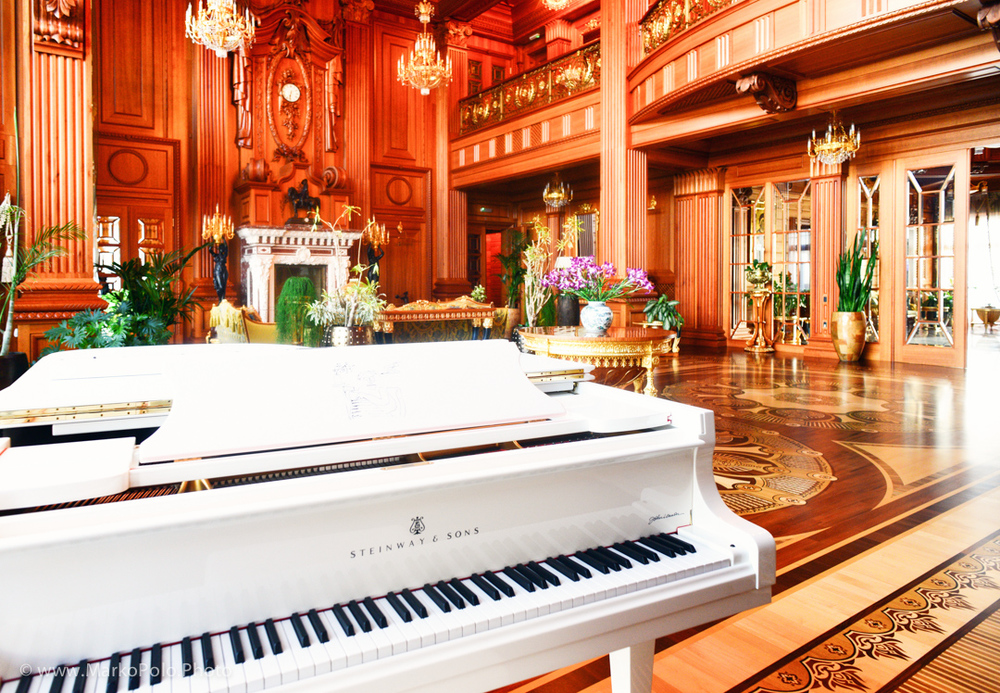 Main room with a fireplace and 17 variety wood floors.  A Steinway & Sons limited edition 'Imagine' grand piano in a reception room. Retailing at £77,200 in 2011 and taking a year to make, the piano is modeled after the white Steinway that John Lennon presented to Yoko Ono on her birthday in 1971 and which featured in Lennon's iconic video for the peace song of the same name. (http://www.telegraph.co.uk)