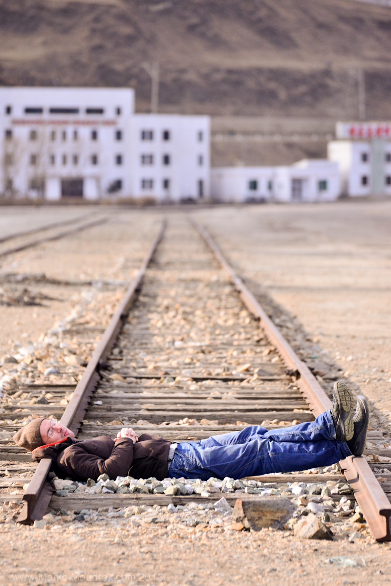 Me laying at the end of a rail road in the port of Rason in the north eastern North Korea