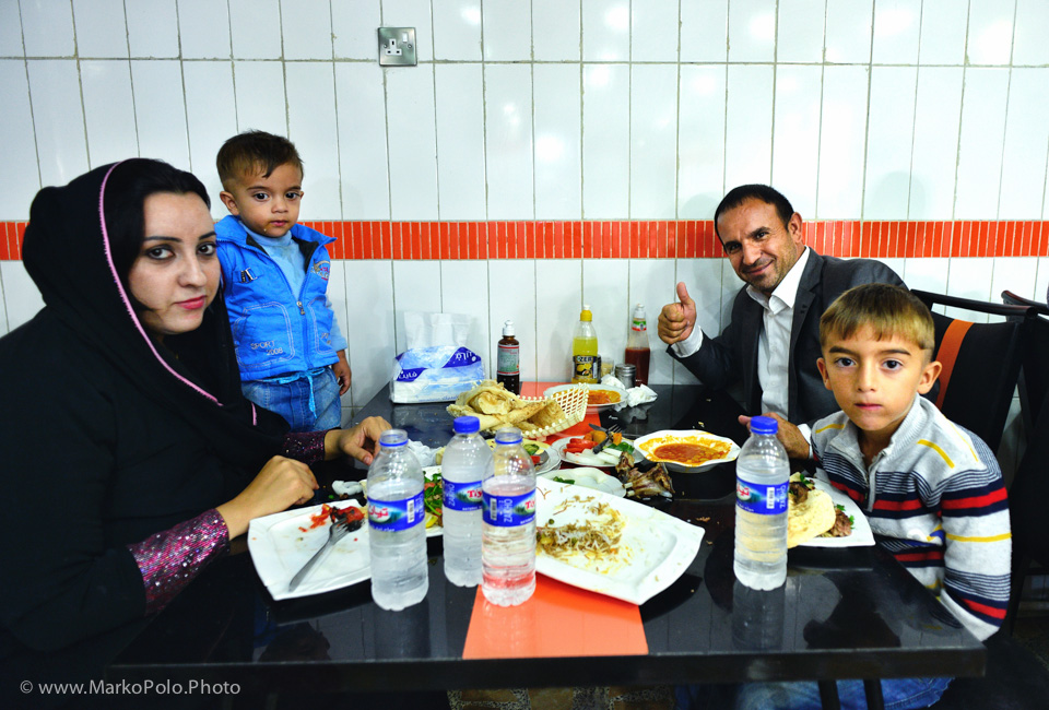 Family enjoying a meal in Erbil