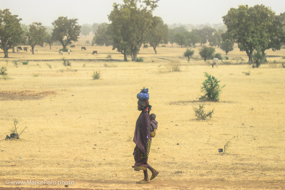 Burkina Faso (1) - A woman with a child in a village near ougodougu