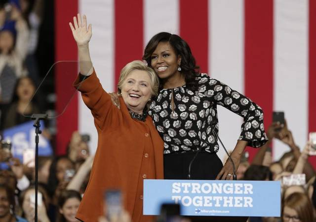 Hillary Clinton and Michelle Obama /photo via AP
