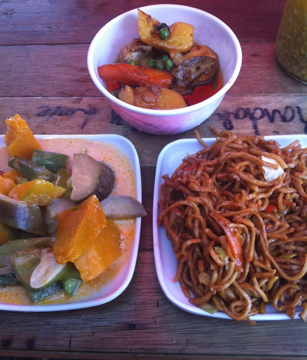 Street food in Manila, including chicken adobo (top), pancit canton (the noodles) and veggies cooked in coconut milk