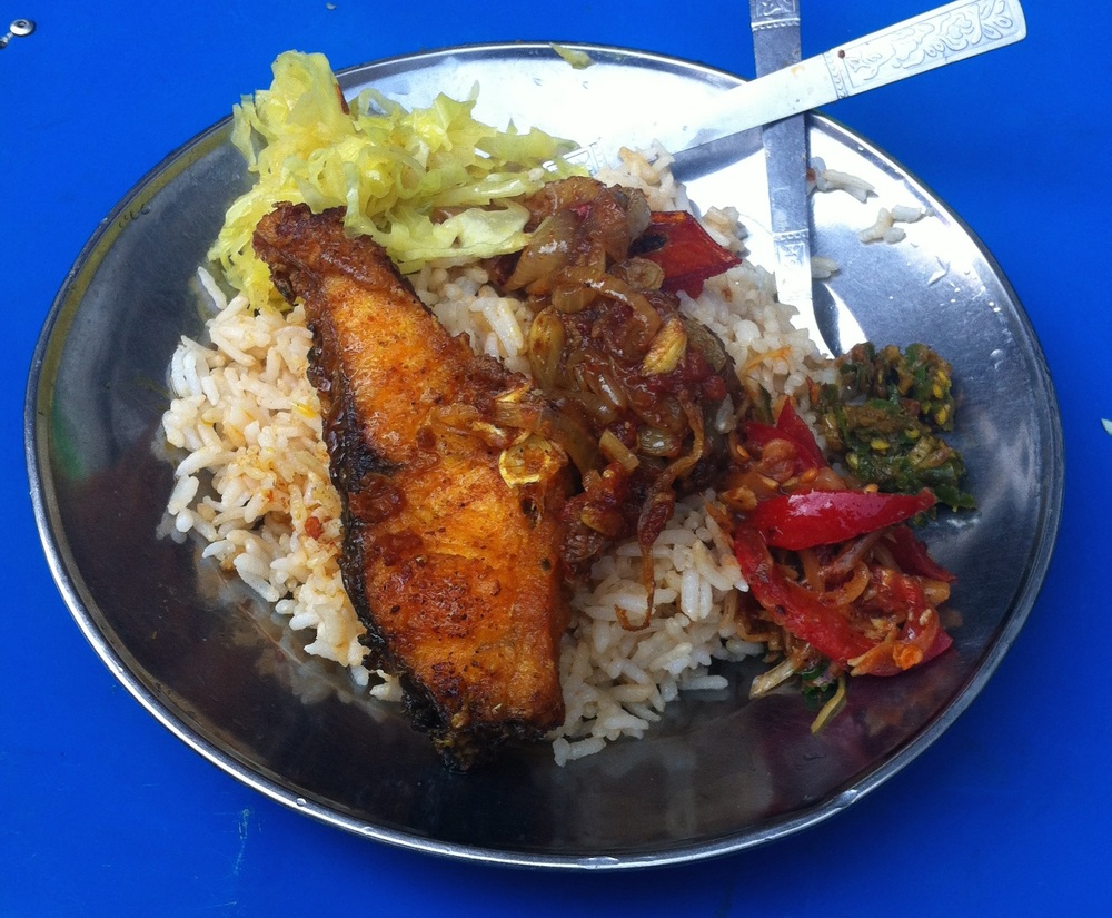 Fish with two curries, cabbage and a chili/fish paste compote. I go to this stand every morning for breakfast. $1