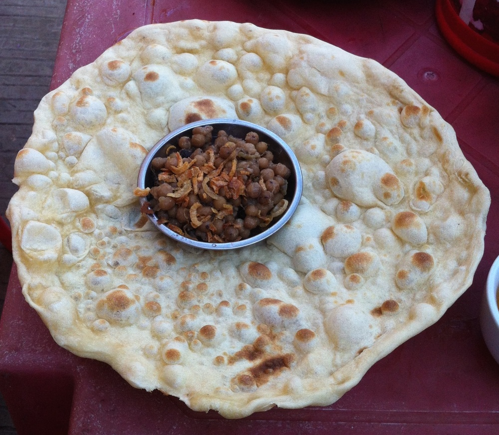 Chapati and chana. I watched him slap the dough to the inside of the tandoori oven. 20 cents.