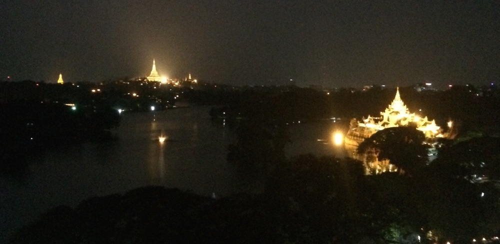 Schwedagon pagoda (left) and Kandawgyi Palace Hotel (right) from a rooftop hotel bar
