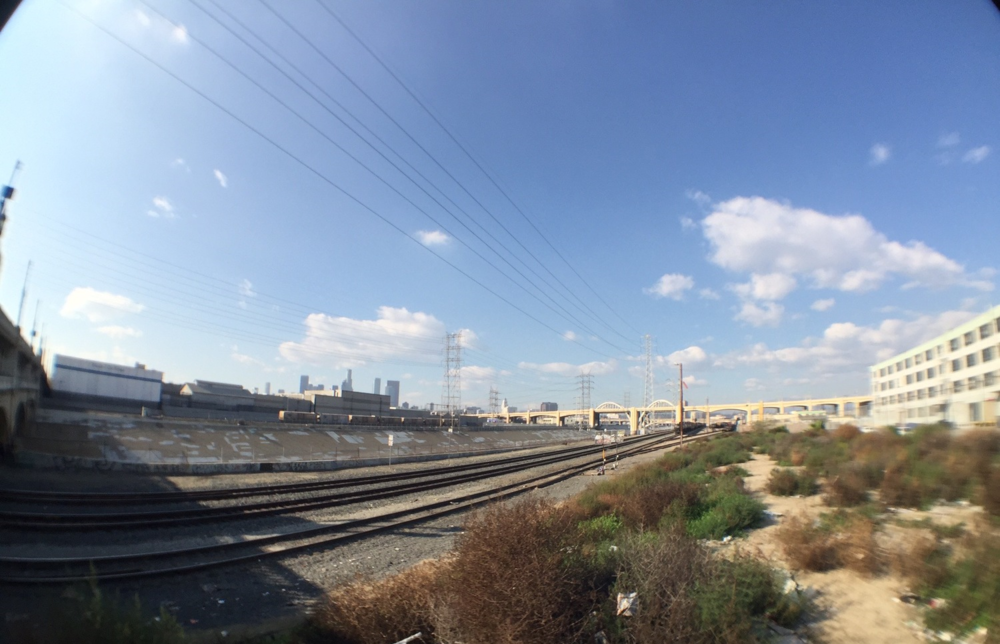View of the L.A. River in the Industrial District of Downtown Los Angeles, taken with an iPhone 6 fish-eye lens attachment.