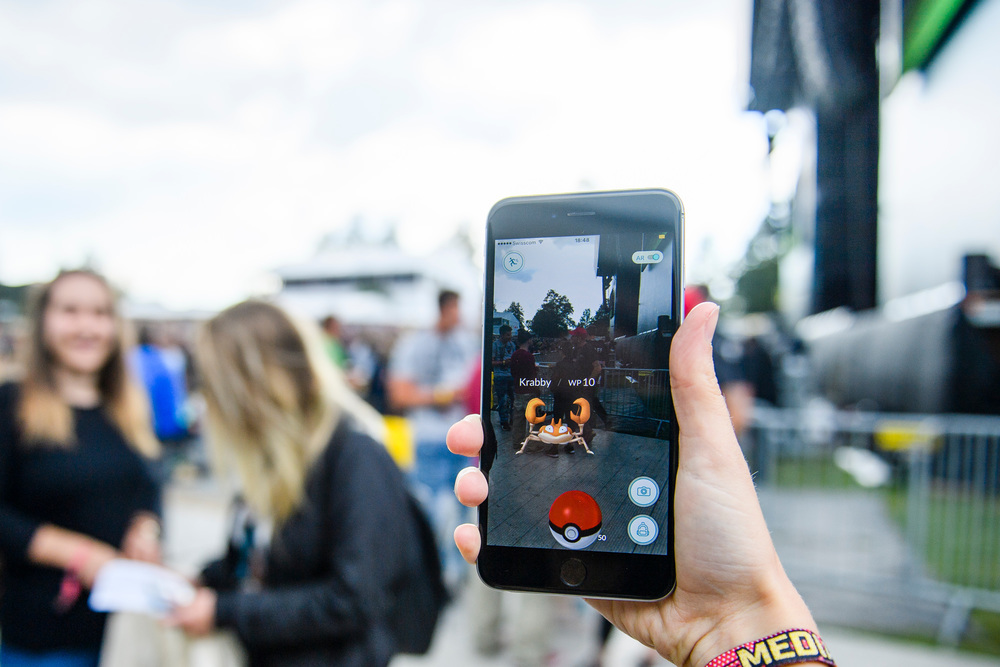 A woman plays PokemonGo at the Gurten music open air festival in Bern, Switzerland, July 15, 2016. The Gurten Festival runs from 14 to 17 July. (KEYSTONE/Manuel Lopez)