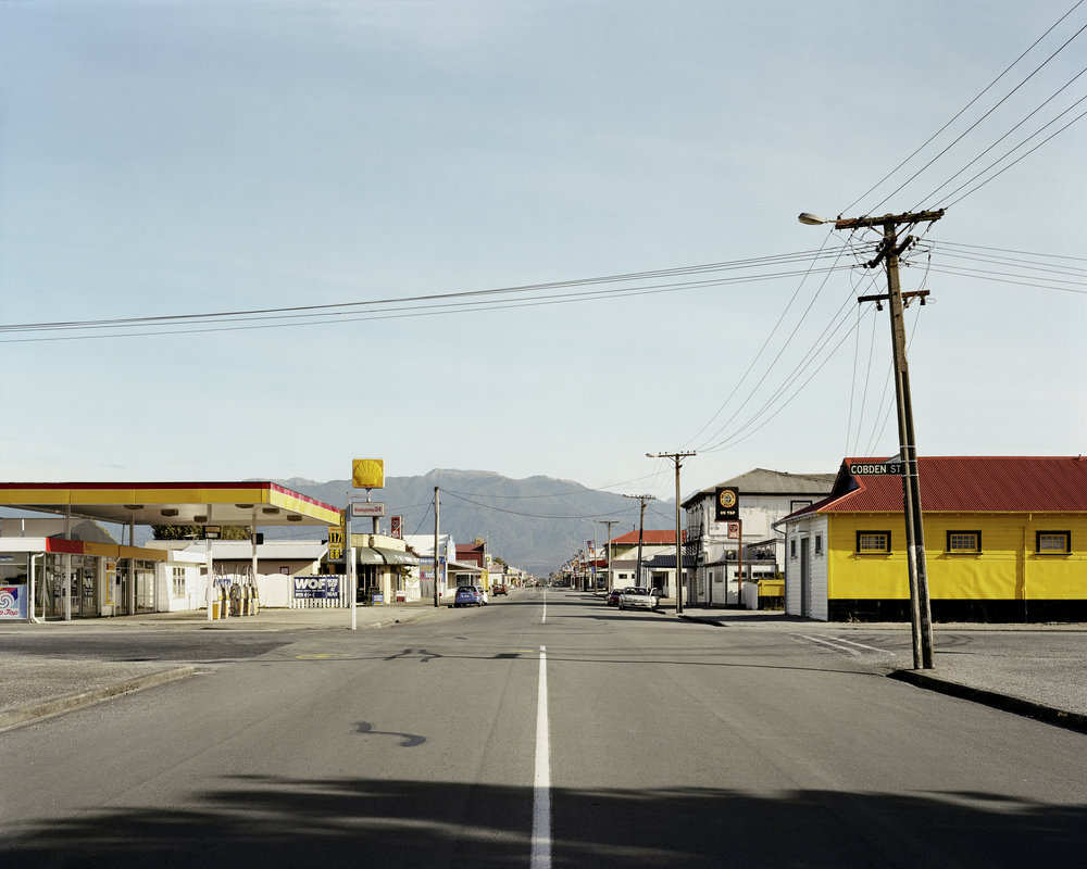 """Palmerston street, Westport, 2004. From the book The Terrible Boredom of Paradise, 2005.    J.M:  6 things that influence your work?   D.H:  1. Miles Davis, the noise he can make with a trumpet. 2.  Dune  the film by David Lynch 3. David Sylvian's song  Orpheus  4. E.M. Cioran """"The real writer writes about being, things, events, he does not write about writing, he uses words but does not linger over them, making them the object of his ruminations. He will be anything and everything except an anatomist of the word. Dissection of language is the fad of those who, having nothing to say, confine themselves to the saying."""" 5. Just about any film by the Cohen Brothers. 6.Charles Bukowski    see more of Dereks work at   https://derekhenderson.net/"""