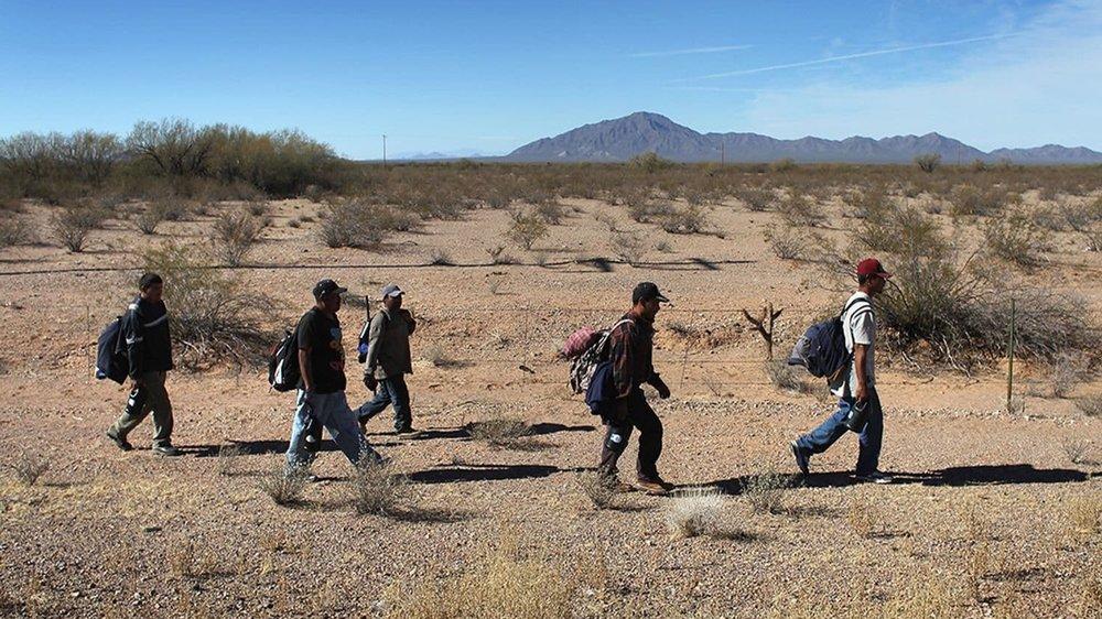 Migrants in desert.jpg
