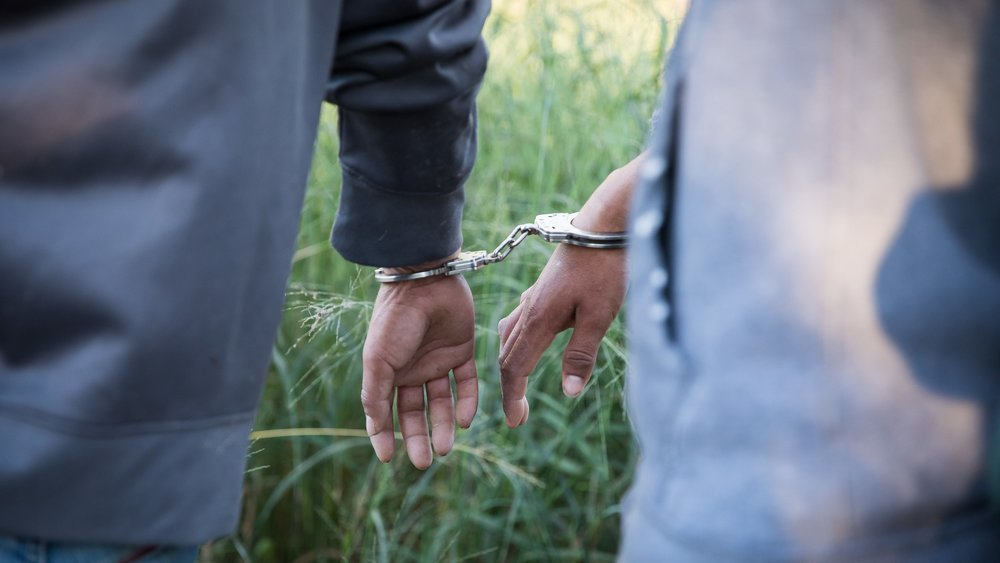 Handcuffed migrants (Border Patrol flickr).jpg
