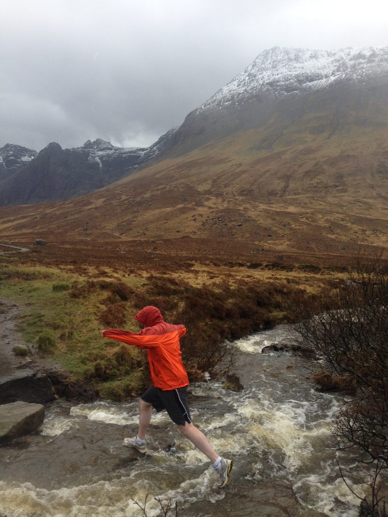Nick leaps over a river on the way to the fairy pools.