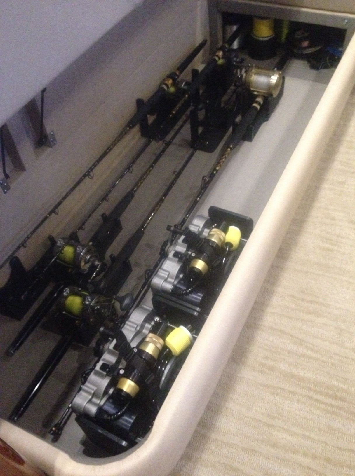 salon sofa rod and reel storage for (6) rigged tyrnos 30s, (1) rigged tiagra 50, and (2) LP s1200 reel cradles