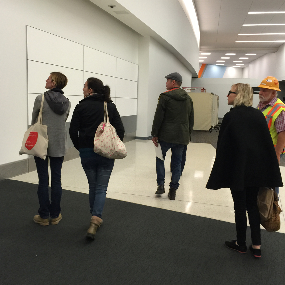 The team surveys the area in Terminal 3 where we will install the mural.