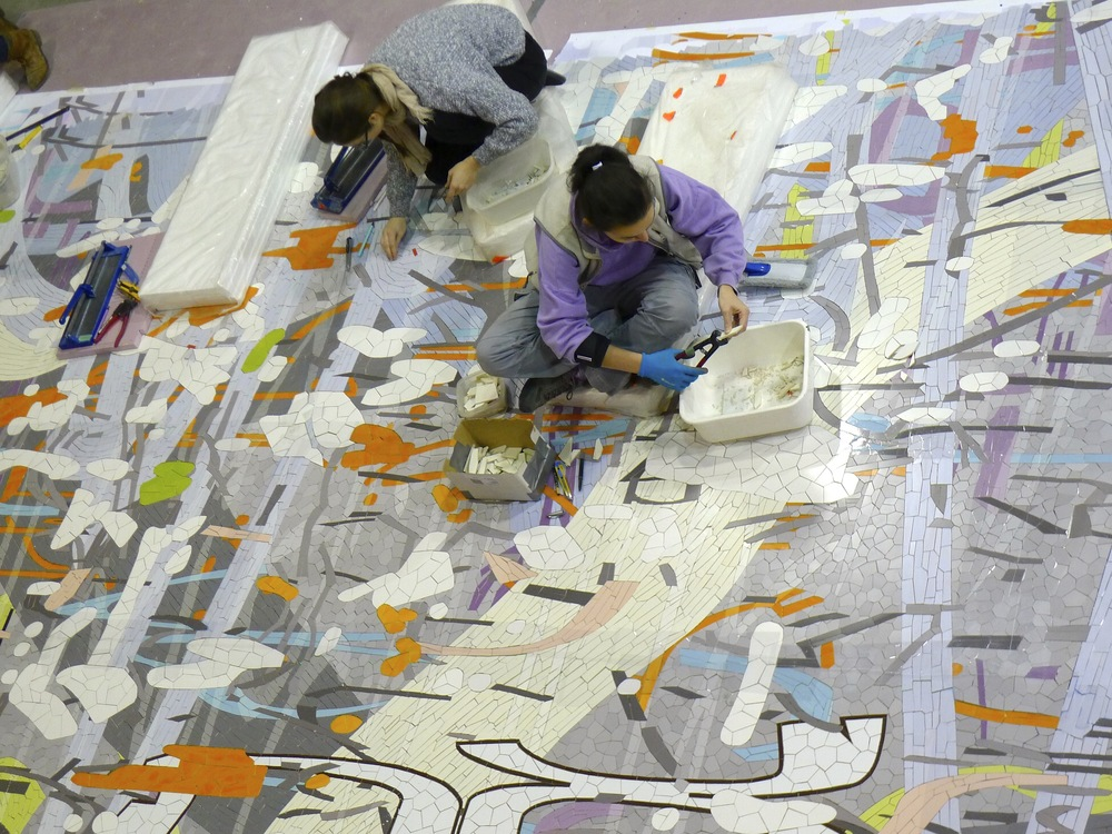 Mosaika artists making changes to the mural before it is packed and shipped to San Francisco.