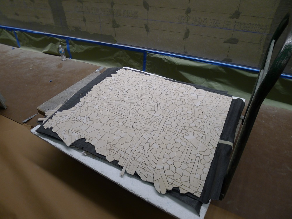The reverse side of the mosaic.  Sticky plastic sheeting is removed from the back and the section is applied to the wall with mortar.