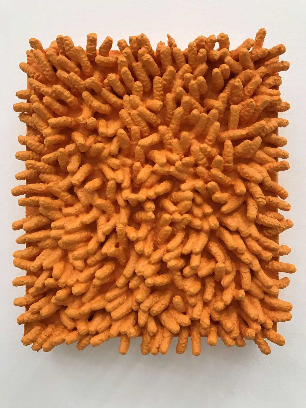 SOFIE RAMOS, outrage, our rage, orange (FTD), 2016. Latex, hand sponge mounted to panel. 5.5 x 4.5 x 4.4 inches.