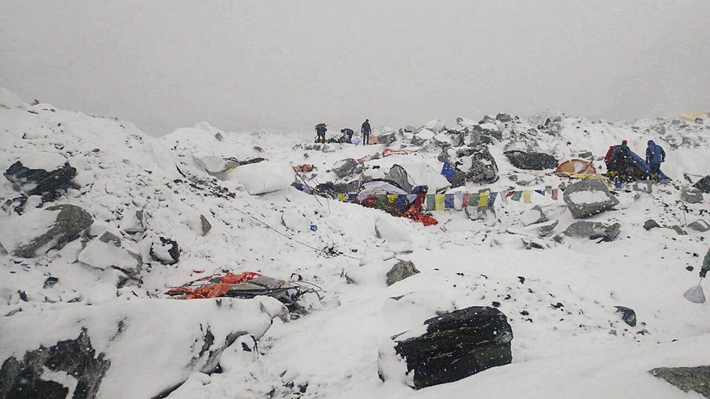 The scene after an avalanche triggered by a massive earthquake swept across Everest Base Camp in Nepal on April 25, 2015.   (Photo: Azim Afif via AP)