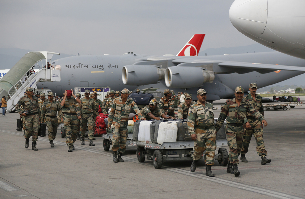 Indian soldiers arrive with supplies at the Tribhuwan International Airport on April 26.     (Photo: Wally Santana, AP)