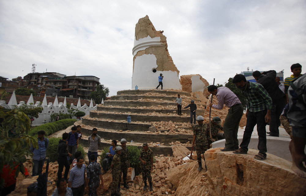 Volunteers work to remove debris at the historic Dharahara Tower in Katmandu, Nepal.     (Photo: Niranjan Shrestha, AP)