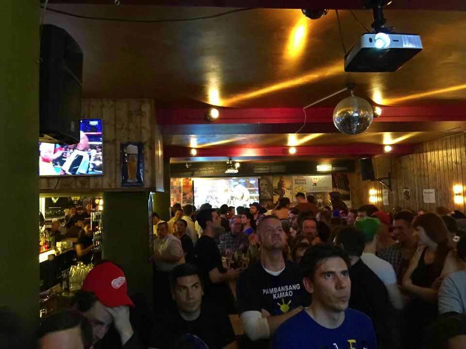 The crowd anxiously watches the fight at The Keg Bar