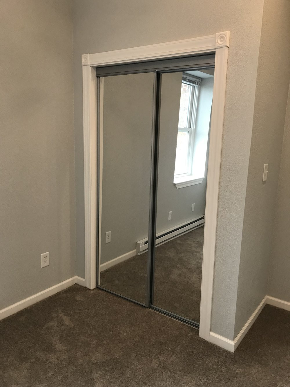 Closet with mirror doors