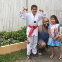 "Fernando's kids Ryan and Sara love helping their dad garden. He says their Backyard Growers garden is ""getting the kids to eat healthier and showing them where their food comes from."""