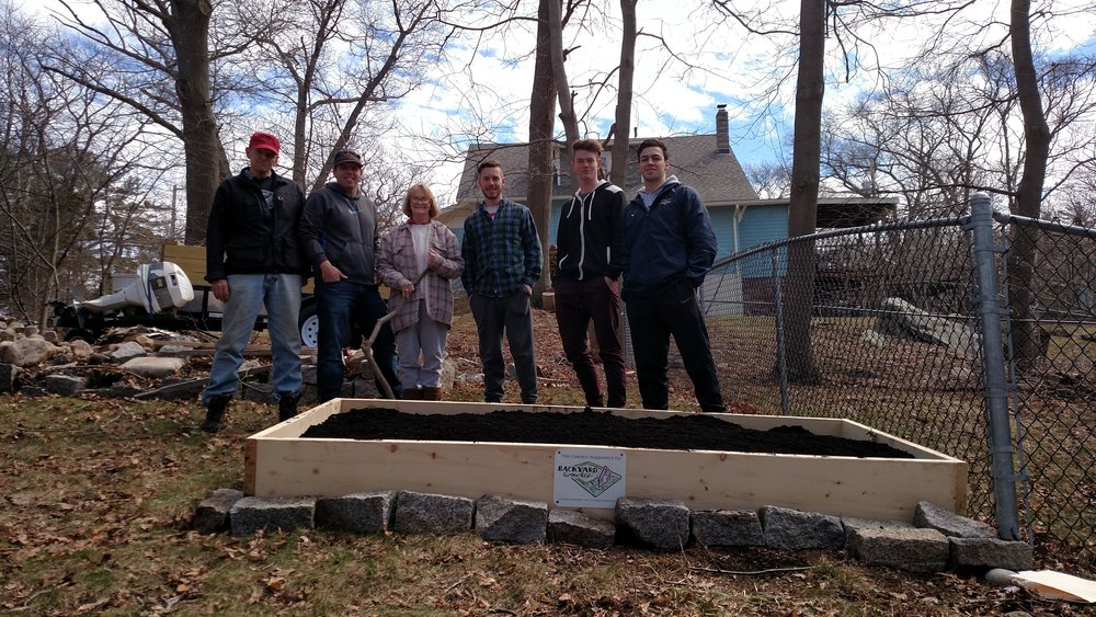Endicott College Soccer team helped build Pat's garden bed.