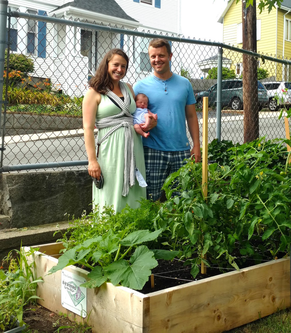 A growing family and their backyard garden
