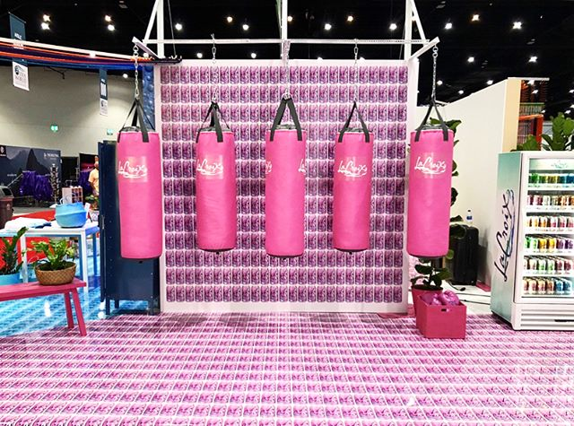Out here at #ideaworld2018 with @lacroixwater with a multi-side active inspired installation! . . . . . . . . . #tradeshow #eventproduction #boxing #lacroix #health #eventplanning #coorporateevent
