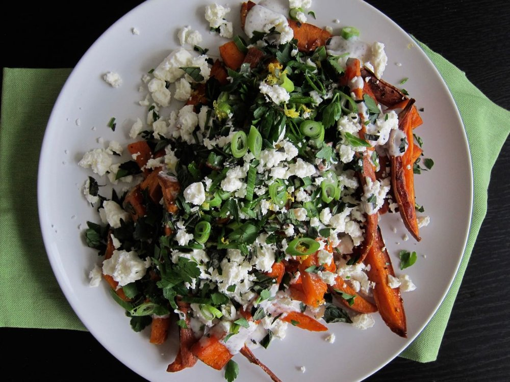 Honey sweet potato fries with sumac yogurt, herbs and feta