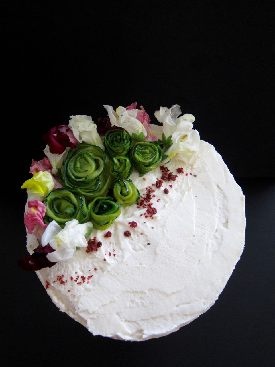 chocolate cake topped with zucchini roses