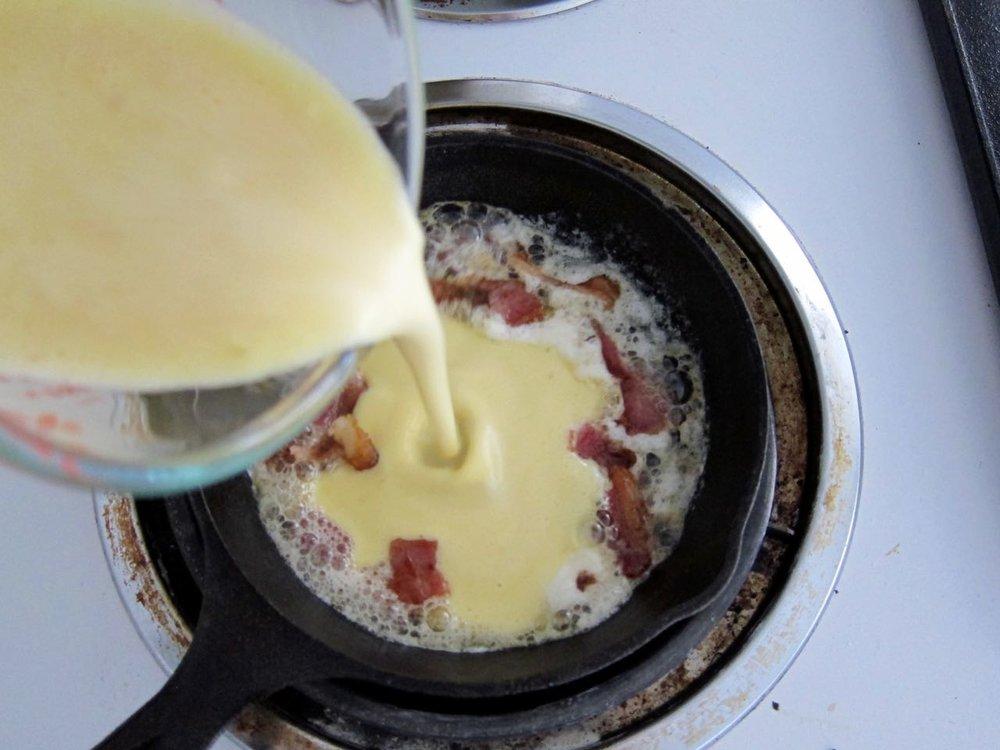 Pouring Dutch Pancake Batter into hot pan.jpg