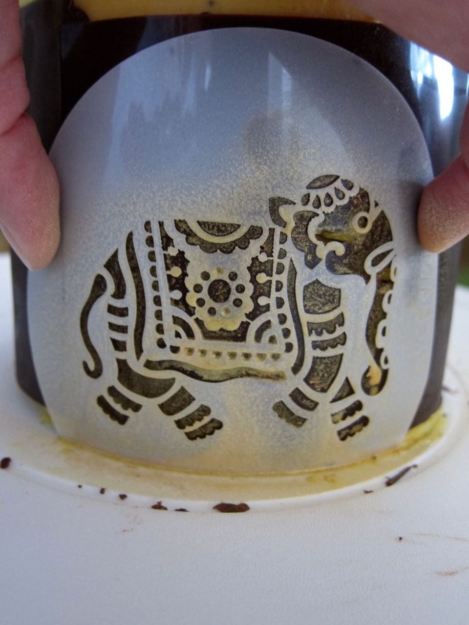 Applying gold spray with Elephant stencil.jpg