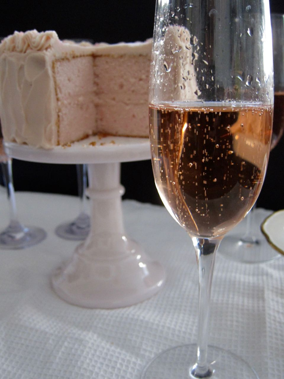 pink champagne and cake