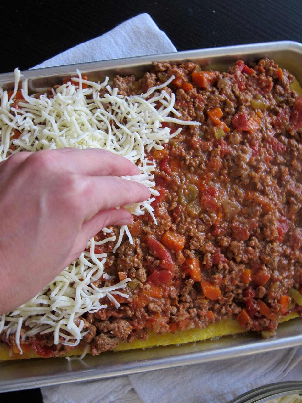 laying cheese on polenta pizza.jpg