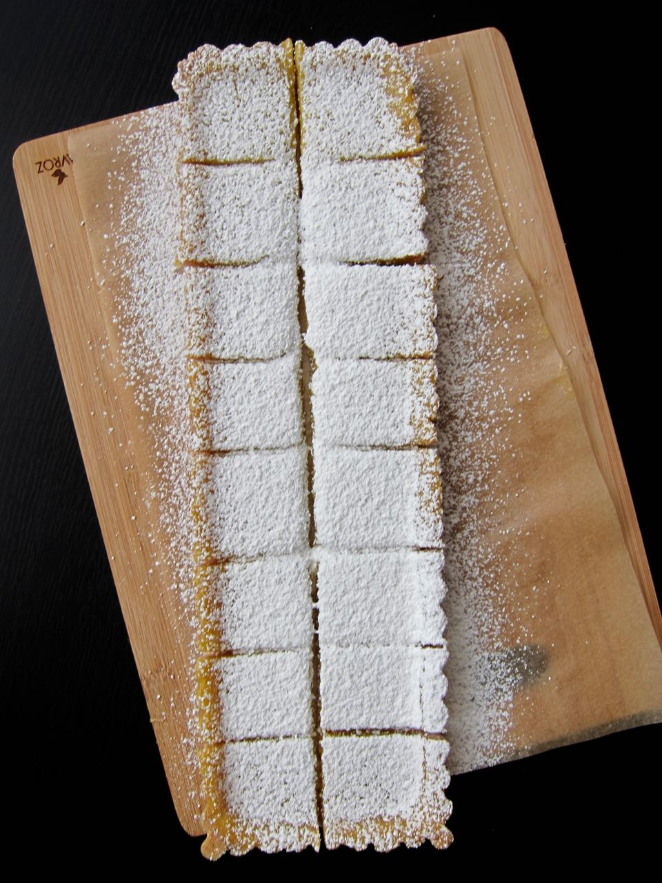 lemon tart squares dusted in powdered sugar.jpg