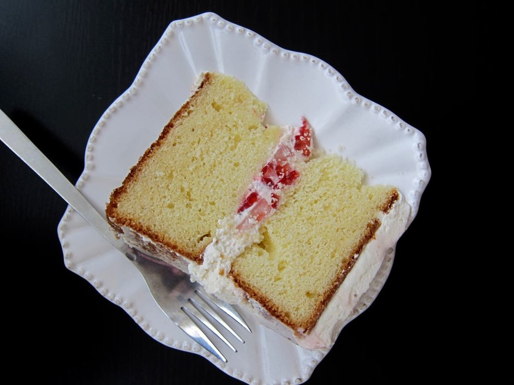 slice of strawberries and cream cake