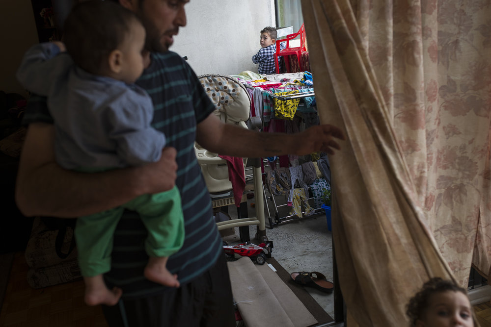Two of his children were born in Syria and his youngest, Basam is born in Canada. They keep him busy when he is home and when he leaves their apartment, the youngest tends to follow him to the door and cries.