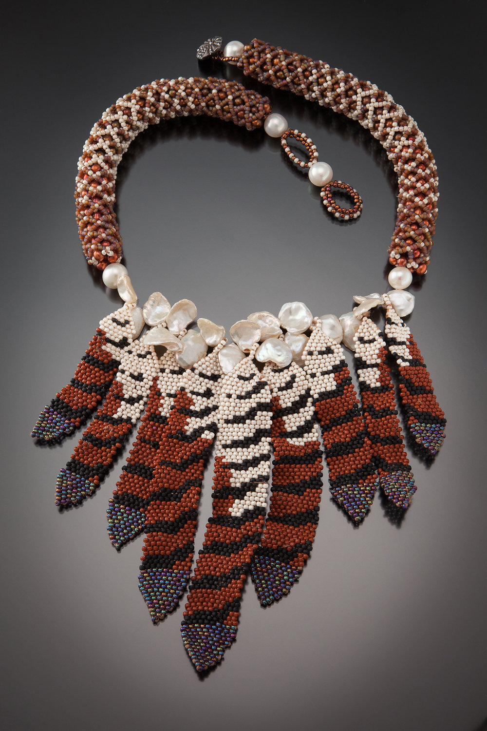 3-karin-alisa-houben-hawk-feather-necklace.jpg