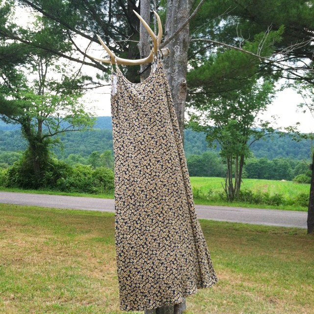 One of the amazing treasures coming to the shop next week #vintage #1990s #sunflower #grunge #dress #deerantlersasahanger 🌻🌻🌻