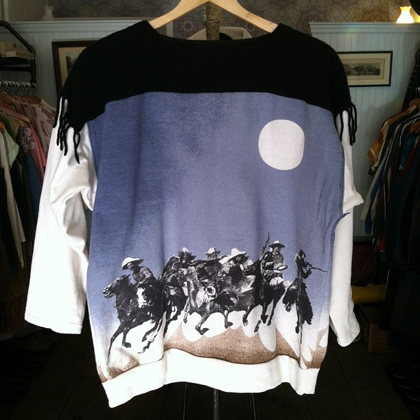 "Probably one of the most amazing pieces we've had in  the shop! #Vintage ""Banditos under the moon"" unisex sweatshirt ($50)…and yes that is shoulder fringe! (at Antoinette)"